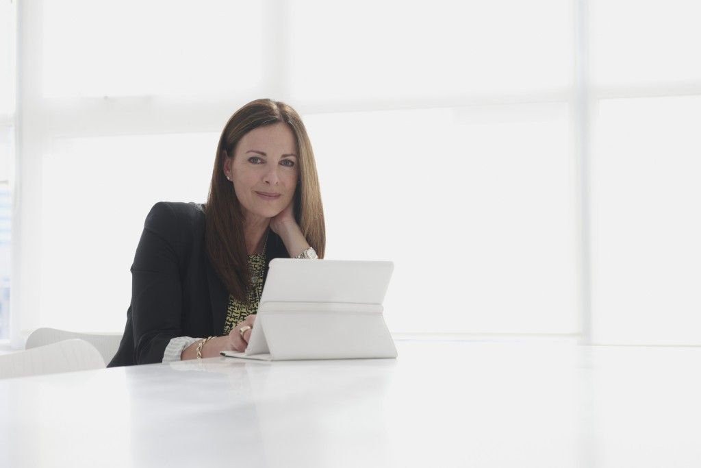 Business woman working in office with digital tablet
